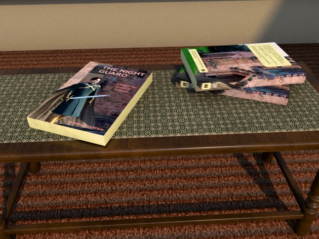 Books created from a 3D program on a table